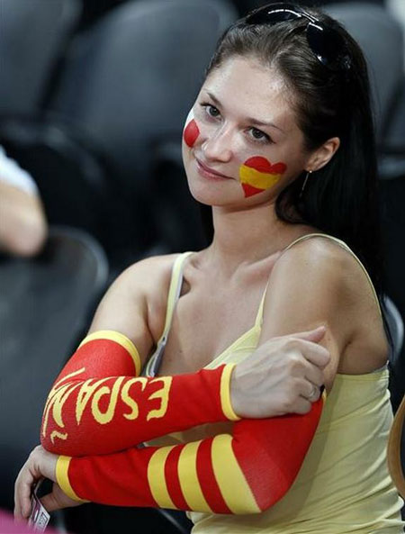 A hot Spanish football supporter with love heart makeup on her face.