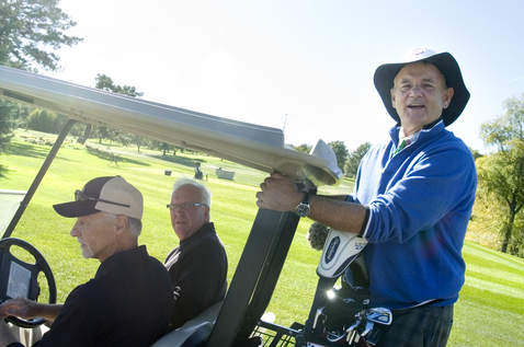 Bill Murray riding a golf cart