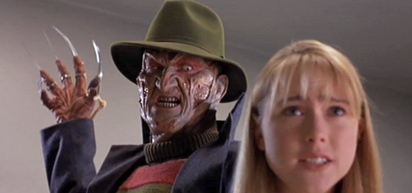 Freddy Krueger about to slash a victim. Freddy Krueger is one of the iconic movie villains that scared you silly.
