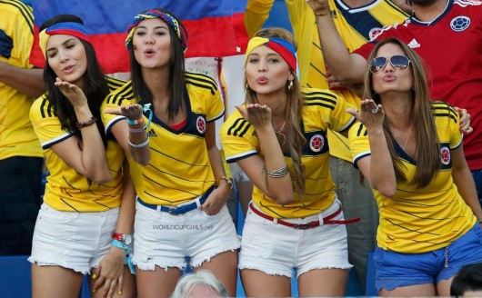 Four hot Colombian World Cup fans blowing a kiss.