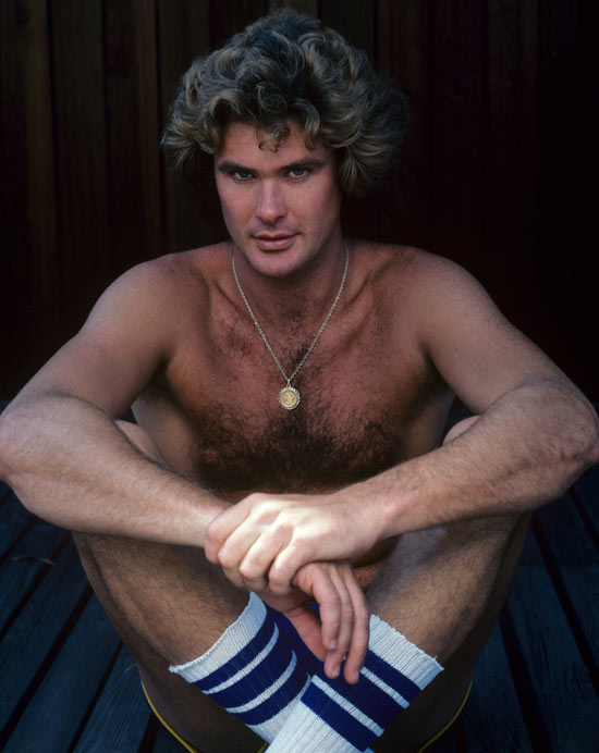 A young David Hasselhoff poses for a photo in just shorts and socks.
