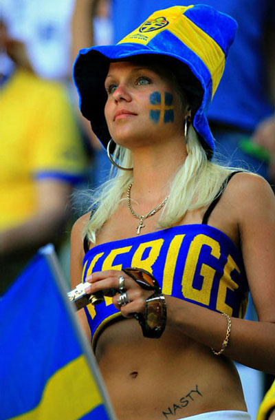 A hot Swedish football fan about to take a photo.