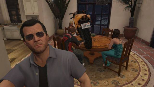 Michael taking a selfie with a motorbike on the table on GTA V.