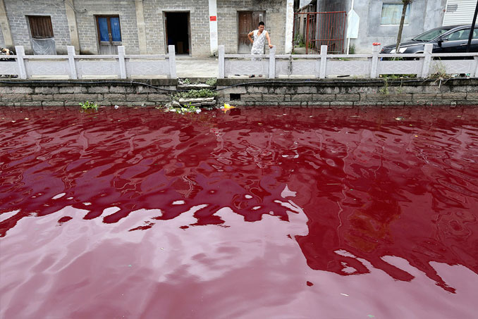 A Photo Of A Blood Red River In Xinmeizhou village, Zhejiang province, China - 10 Eerie Photos That Will Send Shivers Down Your Spine