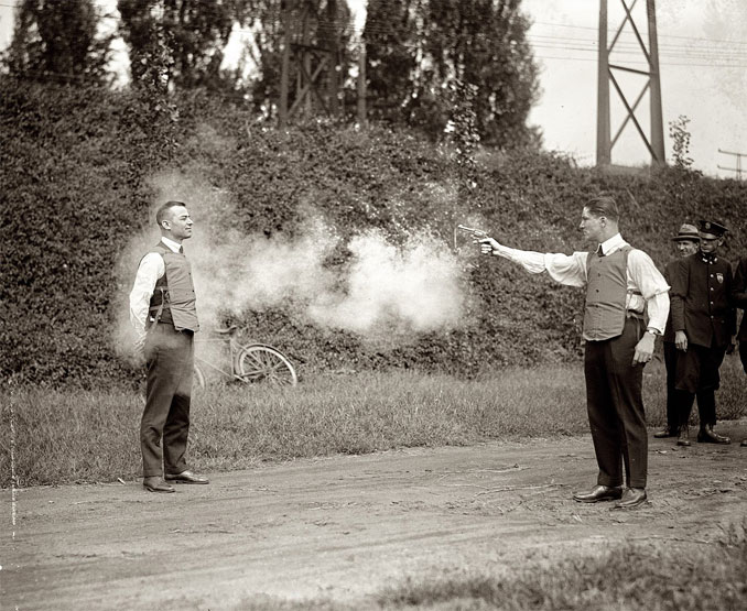A photo of a man testing a bulletproof vest - 10 Rare Photos From History