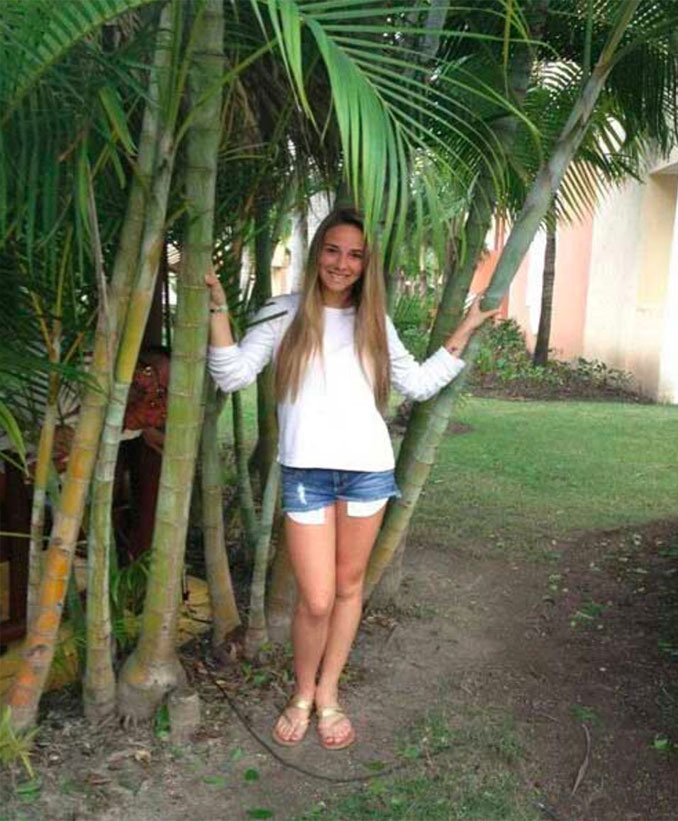 Two scary people photobomb a young girl standing near a palm tree - 10 Most Chilling Photobombs Ever Caught On Camera