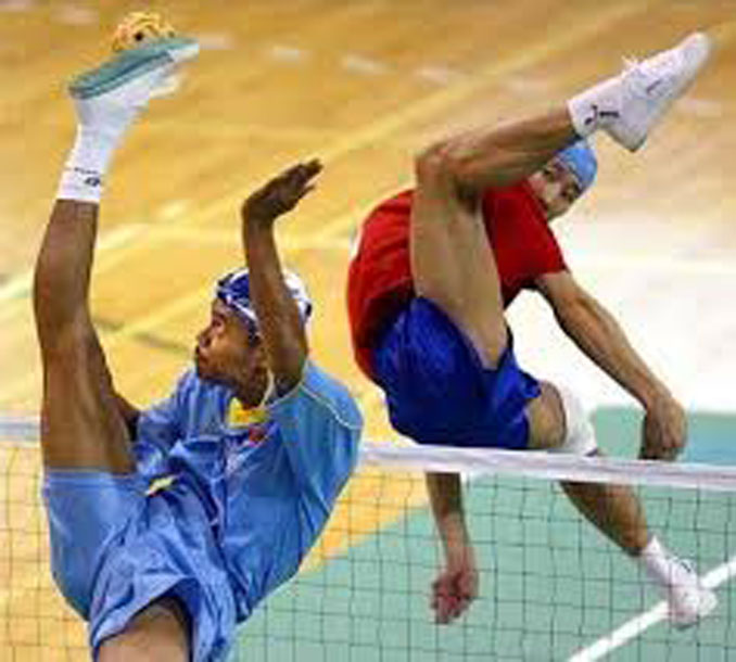 Two men playing Sepak Takraw - 20 WTF Photos You Just Have To See