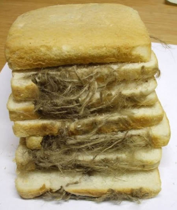 Glove baked into a loaf of bread - Most Disgusting Things Ever Found In Food