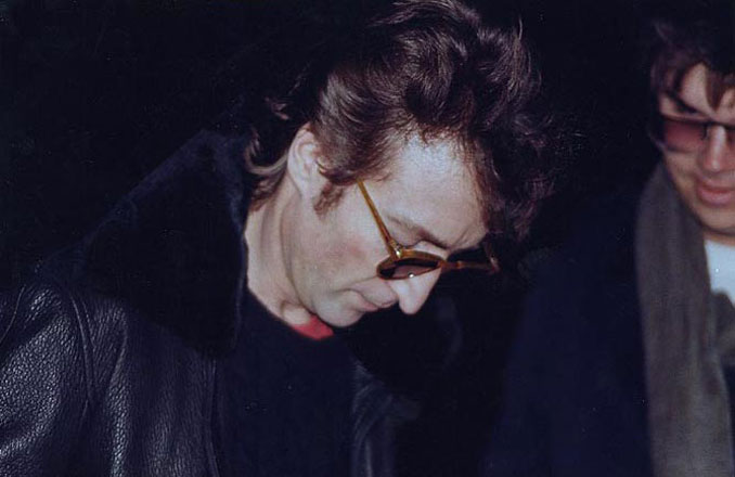 John Lennon signing an autograph for Mark David Chapman - 10 REAL Photos With Unsettling Backstories