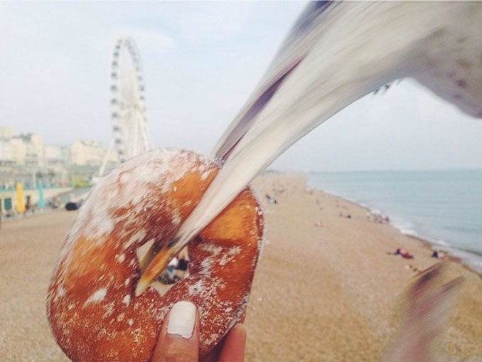 A bird stealing a donut - 20 Funny Animal Photos You Have To See