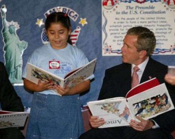 This picture of former president George Bush holding a book upside down is actually a hoax