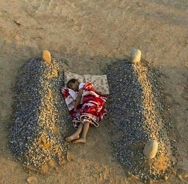 This was supposedly a Syrian boy sleeping between his two dead parents, it was a hoax