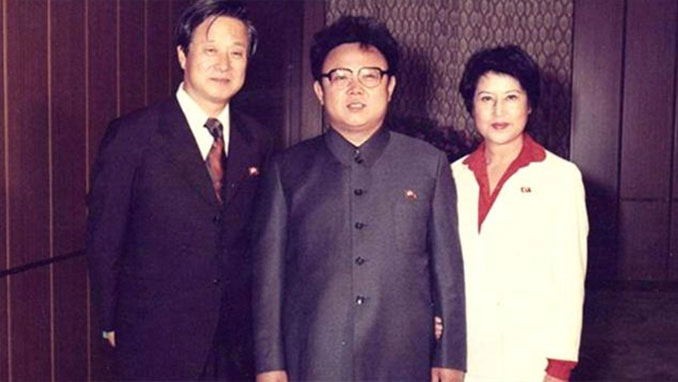 Kim Jong il standing with South Korean film director Shin Sang-ok and former wife, actress Choi Eun-hee - 10 REAL Photos That Are Hiding A Dark Secret