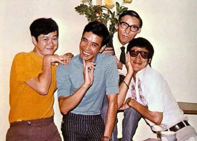Bruce Lee joking around with friends.