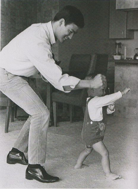 Bruce Lee teaching his son Brandon Lee martial arts.
