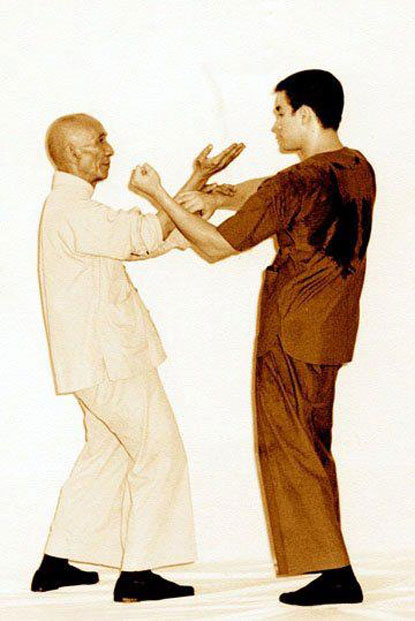Bruce Lee training with Ip Man.