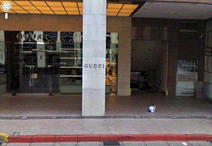 A baby all by itself out the front of a Gucci store seen on Google Street View.