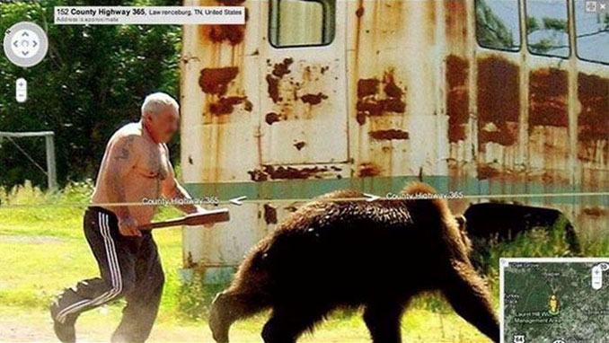 A man chasing a bear with a baseball bat seen on Google Street View.