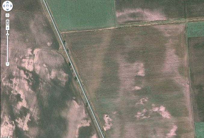 An image of Jesus in a field seen on Google Earth.