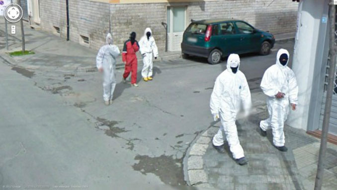 Men in white overalls and face masks on Google Maps.