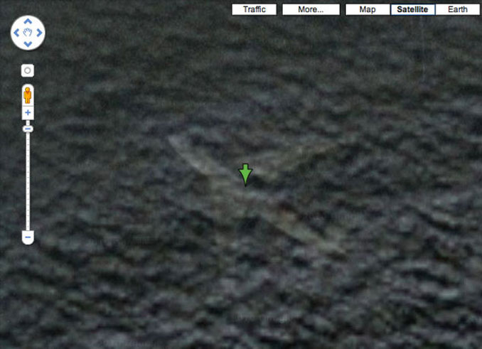 A close up of a plane at the bottom of the ocean seen on Google Earth.