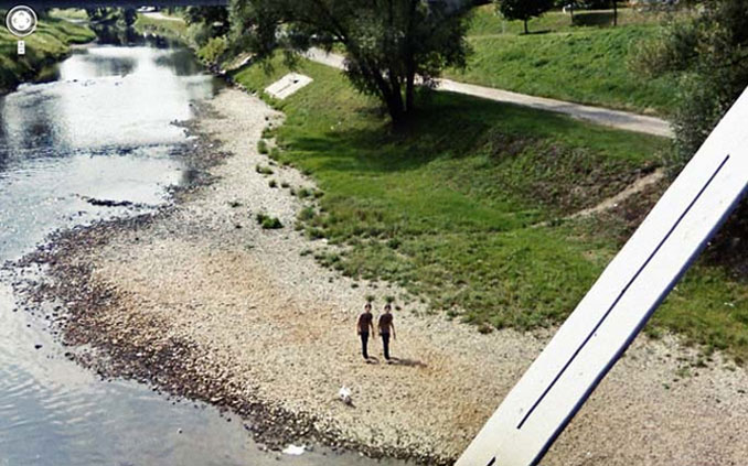 Twin boys walking next to a river seen on Google Maps.