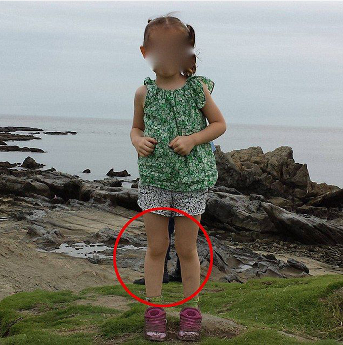 A photo of a ghost of a samurai standing behind a young girl taken in Zushi, Japan.