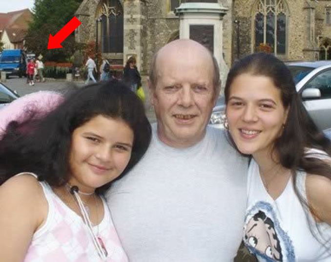 Michael Dick posing for a photo with his two daughters.