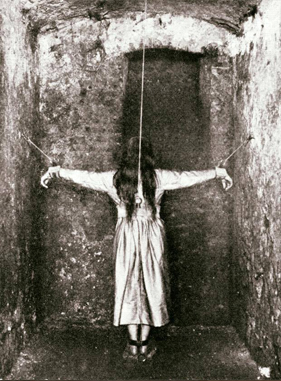 This is one of many real, creepy photos, this one depicts the act of forced standing. A so-called treatment in 1890