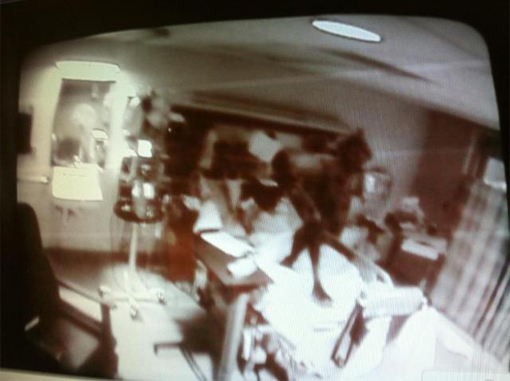 This is one of many real creepy photos, this one is a demon in a hospital visiting a dying patient.
