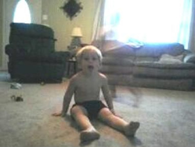 Ghost seen behind boy in living room - 10 Photos of Ghost Children That Have Everyone Scared