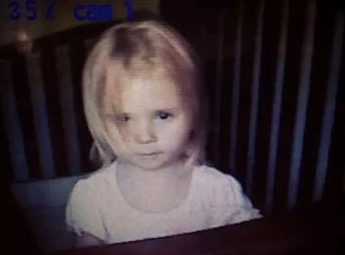 Creepy young girl seen on baby monitor - 10 Terrifying Things Caught on Baby Monitors