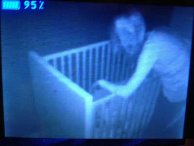 Scary woman leaning over crib seen on baby monitor - 10 Terrifying Things Caught on Baby Monitors