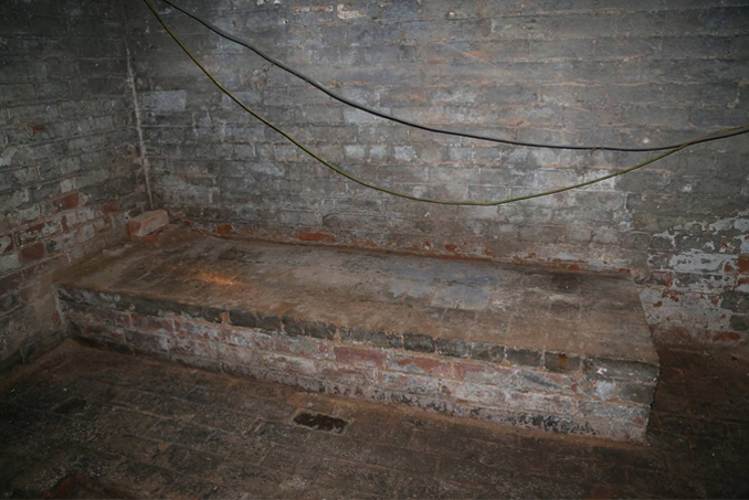 Secret dungeon discovered under an apartment - 10 Creepiest Secret Rooms Ever Discovered