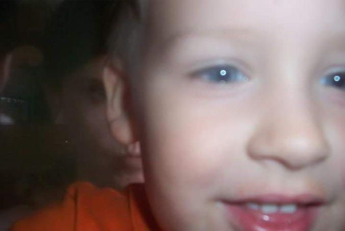 Mysterious man appears behind boy in photo - 10 Scary Ghost Photos That No One Can Explain