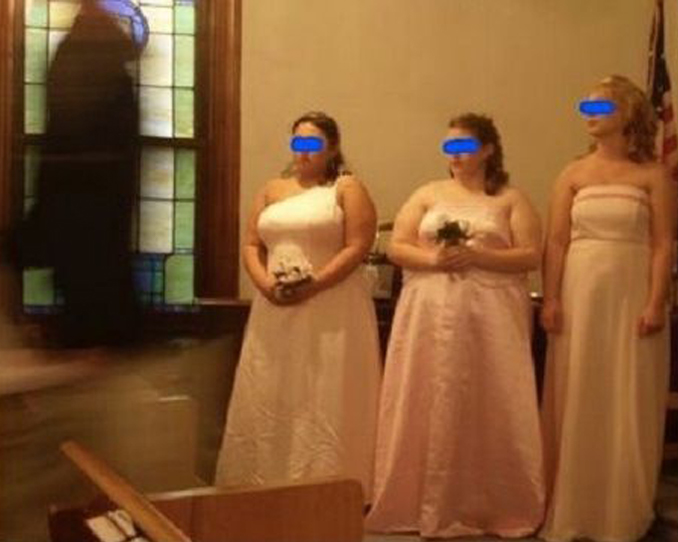 Dark, hooded figure appears during wedding photo - 10 Creepy Church Ghost Sightings Caught on Camera