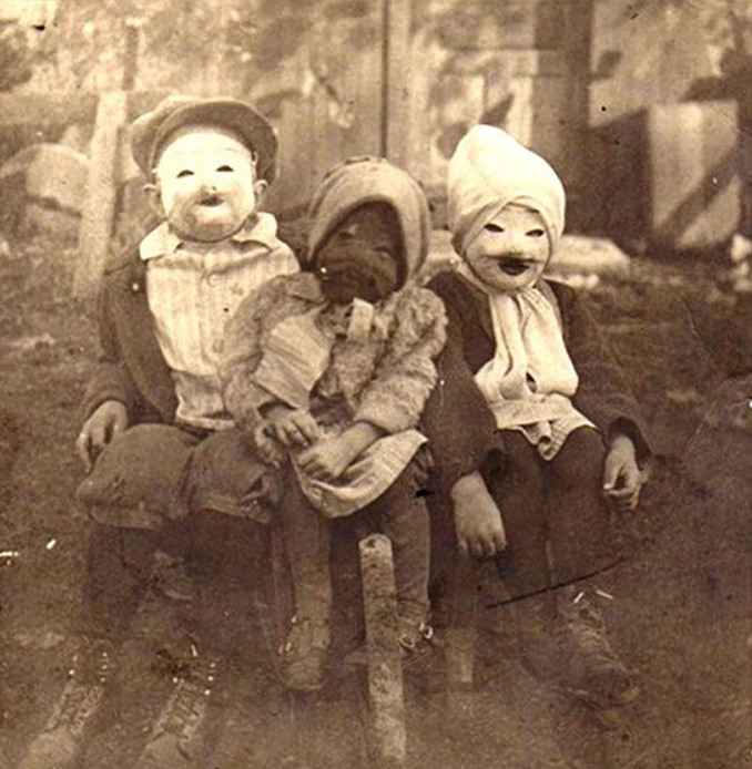 Three children dressed in Halloween costumes - The Scariest Halloween Costumes of All Time