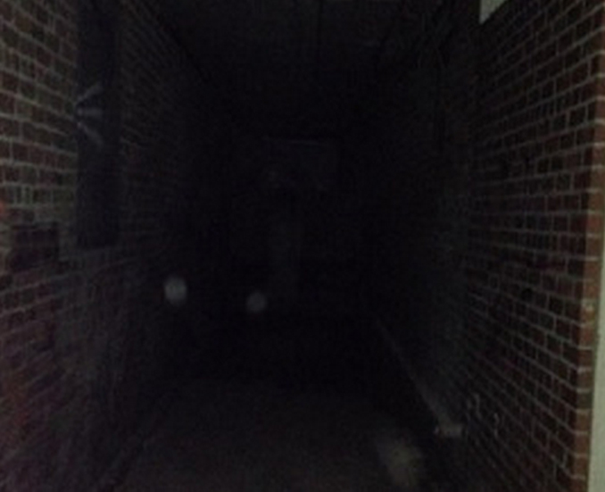 Ghost photographed at Peoria State Hospital in Bartonville, Illinois - These Hospital Ghost Sightings Have Patients and Staff Worried