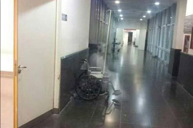 A ghost photographed in a wheelchair at Clemente Alvarez Emergency Hospital in Argentina - These Hospital Ghost Sightings Have Patients and Staff Worried