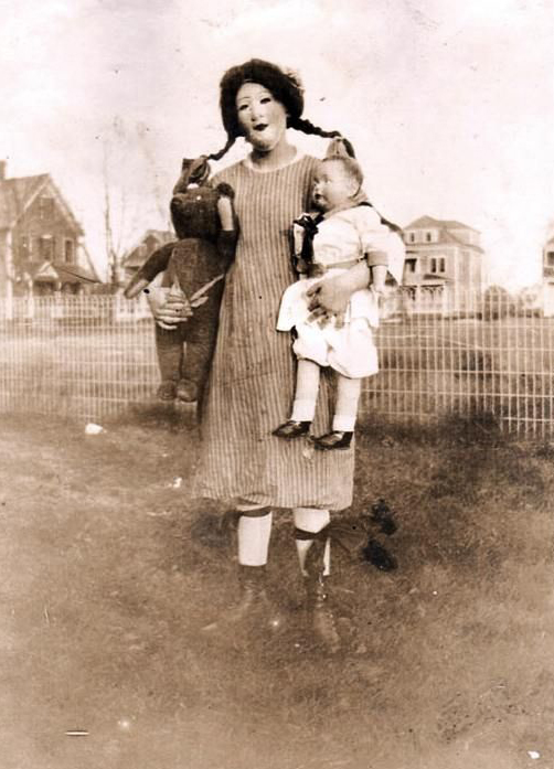 A woman dressed in a doll Halloween costume - The Scariest Halloween Costumes of All Time