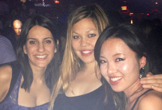Creepy man photobombing three women - These Creepy Photos Cannot be Explained