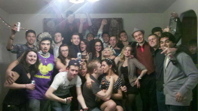 Unknown guest appears in group photo - These Creepy Photos Cannot be Explained