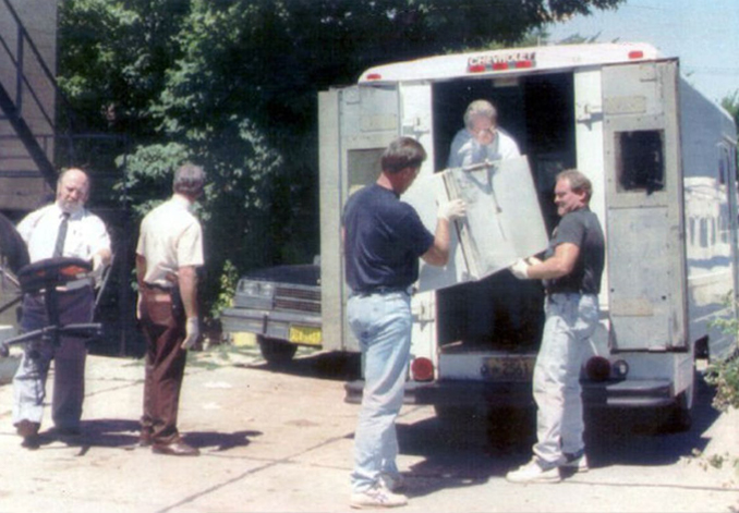 Jeffrey Dahmer's refrigerator being loaded into a van - These Real Photos Have Very Disturbing Backstories