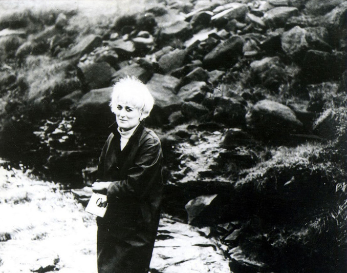 Myra Hindley standing on the moors - These Real Photos Have Very Disturbing Backstories