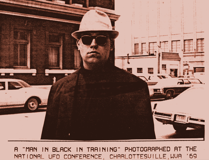 Photograph of a man in black taken by Allen Greenfield outside the 1969 National UFO Conference in Charlottesville, Virginia - Real Men in Black Sightings Caught on Camera