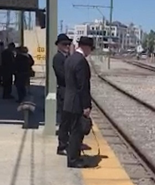 Photo of the Men in Black near the Bienville Street station outside the French Quarter in New Orleans, Louisiana - Real Men in Black Sightings Caught on Camera
