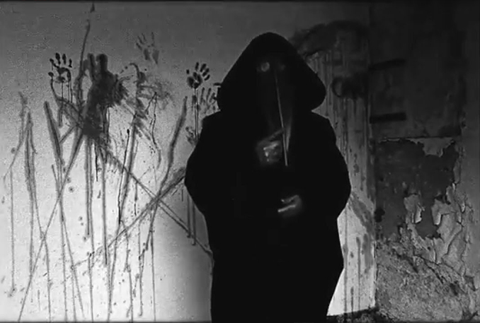 A still from the video 11B-X-1371 or Plague Doctor. An unsolved internet mystery