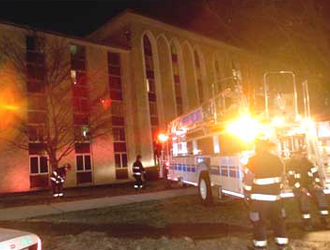Fire trucks attending Boland Hall fire, which students thought was a false alarm.