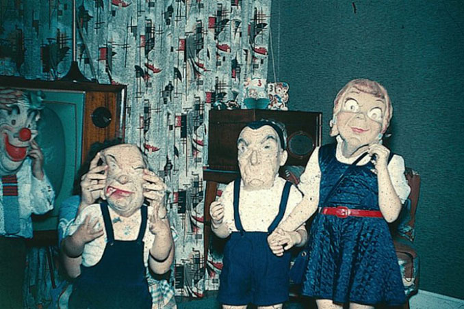 A cursed photo from the dark web showing three children in masks