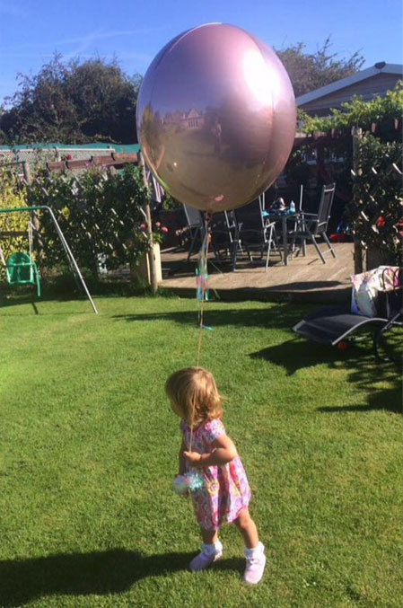 Scary pictures of a ghost of great grandmother seen in balloon's reflection.